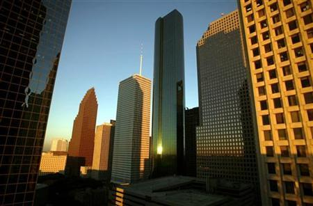 Buildings in downtown Houston reflect the light of a setting sun October 15, 2004.