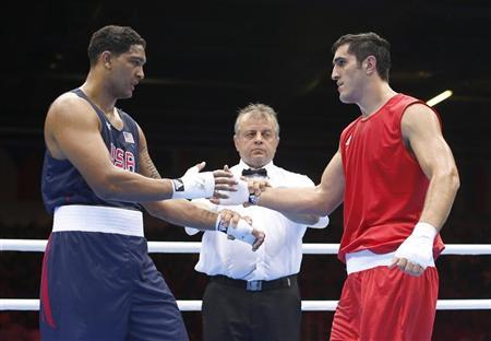 Russia's Magomed Omarov (R) shakes hands with Dominic Breazeale of the U.S. after Omarov won their Men's Super Heavy (+91kg) Round of 16 boxing match during the London 2012 Olympic Games August 1, 2012. REUTERS/Murad Sezer