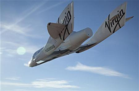 The Virgin Galactic SpaceShip2 (VSS Enterprise) glides toward Earth on its first test flight after being released from its WhiteKnight2 (VMS Eve) mothership over Mojave, California October 10, 2010. REUTERS/Mark Greenberg-Virgin Galactic/Handout