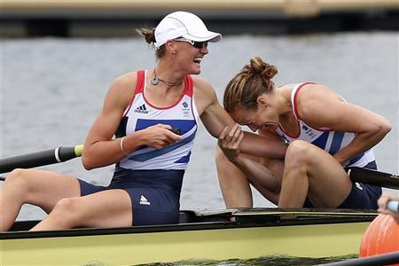 Britain's Helen Glover and Heather Stanning react after winning the women's pair rowing final at Eton Dorney during the London 2012 Olympic Games August 1, 2012. REUTERS/Jim Young