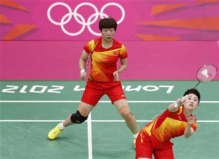 China's Wang Xiaoli (L) and Yang Yu play against Russia's Nina Vislova and Valeria Sorokina in their women's doubles group play stage badminton match at the Wembley Arena during the London 2012 Olympic Games July 29, 2012. REUTERS/Bazuki Muhammad