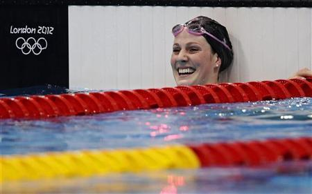 Missy Franklin of the U.S. celebrates after winning the women's 100m backstroke final at the London 2012 Olympic Games at the Aquatics Centre July 30, 2012. REUTERS/Tim Wimborne