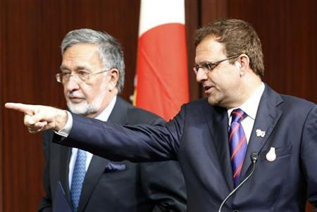 Afghanistan's Finance Minister Omar Zakhilwal (R) gestures next to Foreign Minister Zalmai Rassoul at their joint news conference with Japan's Foreign Minister Koichiro Gemba at the Tokyo Conference on the Reconstruction of Afghanistan in Tokyo July 8, 2012. REUTERS/Kim Kyung-Hoon