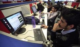 Employees of Snapdeal.com, an Indian online discount shopping website, work inside their company office in New Delhi March 1, 2012. REUTERS/Parivartan Sharma