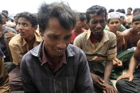 Rohingyas from Myanmar cry after being arrested by Border Guards of Bangladesh (BGB) while trying to get into Bangladesh, in Teknaf June 18, 2012. REUTERS/Andrew Biraj/Files