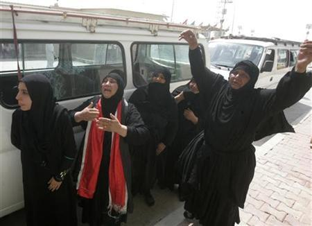 Women mourn during a funeral of a victim who was killed in the Baghdad bombings in Najaf, around 160 km (99 miles) south of Baghdad, August 1, 2012. REUTERS/Ali Abu Shish