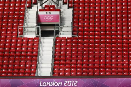 Empty seats are seen during the men's Group D football match between Spain and Morocco at the London 2012 Olympic Games at Old Trafford in Manchester August 1, 2012. REUTERS/Andrea Comas