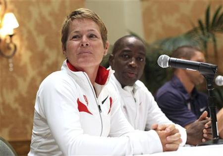 Amy Deem, women's Olympic team coach, (L) and Andrew Valmon, men's Olympic team coach, listen to questions at a media conference at the U.S. Olympic athletics trials in Eugene, Oregon, June 26, 2012. REUTERS/Robert Galbraith