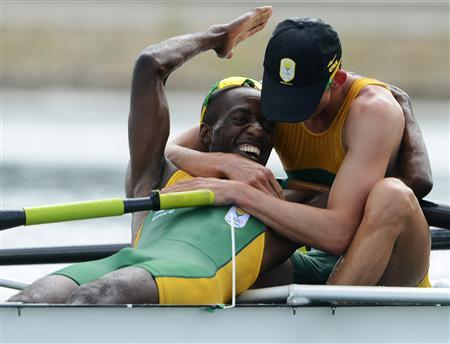 South Africa's John Smith (R) and Sizwe Ndlovu celebrate after winning the gold medal in the men's lightweight four final rowing event event during the London 2012 Olympic Games at Eton Dorney August 2, 2012. REUTERS/Pool