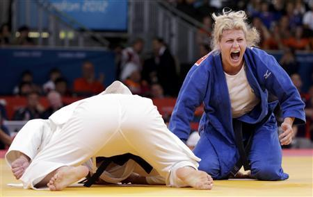 Kayla Harrison of the U.S. reacts after defeating Brazil's Mayra Aguiar (white) in their women's -78kg semi-final A judo match at the London 2012 Olympic Games August 2, 2012. REUTERS/Toru Hanai