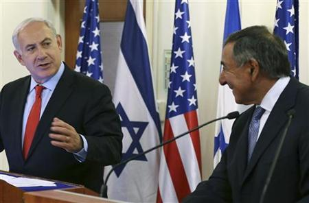 Israeli Prime Minister Benjamin Netanyahu (L) listens as U.S. Defense Secretary Leon Panetta (R) speaks to the media before a meeting at the Prime Minister's office in Jerusalem August 1, 2012. REUTERS/Mark Wilson/Pool
