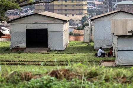 A family suspected to have contracted the ebola virus is seen from a distance at an isolation camp in Mulago hospital in Uganda's capital of Kampala July 31, 2012. REUTERS/Edward Echwalu