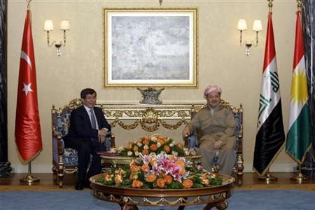 Kurdistan Region President Masoud Barzani (R) meets with Turkish Foreign Minister Ahmet Davutoglu in Arbil, about 350 km (220 miles) north of Baghdad, August 1, 2012. REUTERS/Azad Lashkari