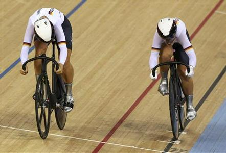 Germany's Kristina Vogel and Miriam Welte (L) compete in the track cycling women's team sprint qualifying heats at the Velodrome during the London 2012 Olympic Games August 2, 2012. REUTERS/Stefano Rellandini