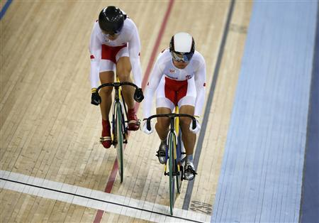 China's Gong Jinjie (R) and Guo Shuang compete in the track cycling women's team sprint qualifying heats at the Velodrome during the London 2012 Olympic Games August 2, 2012. Team China set a new world record of 32.447 seconds. REUTERS/Paul Hanna