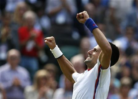 Serbia's Novak Djokovic celebrates after defeating France's Jo-Wilfried Tsonga in their men's singles quarterfinals tennis match at the All England Lawn Tennis Club during the London 2012 Olympic Games August 2, 2012. REUTERS/Stefan Wermuth