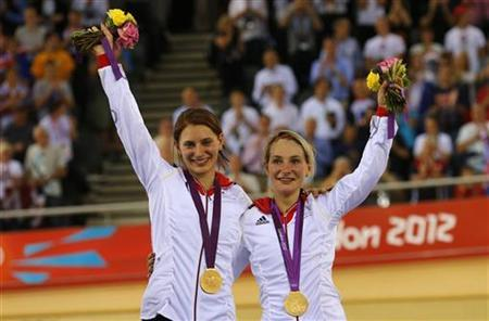 Germany's Kristina Vogel (R) and Miriam Welte celebrate with their gold medals during the victory ceremony after the track cycling women's team sprint finals at the Velodrome during the London 2012 Olympic Games August 2, 2012. REUTERS/Cathal McNaughton