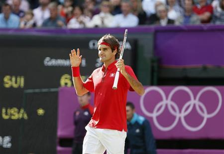 Switzerland's Roger Federer celebrates after defeating John Isner of the U.S. in their men's singles quarterfinals tennis match at the All England Lawn Tennis Club during the London 2012 Olympic Games August 2, 2012. REUTERS/Stefan Wermuth