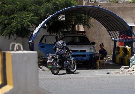 Police troopers guard outside the Italian embassy in Sanaa July 30, 2012. REUTERS/Khaled Abdullah