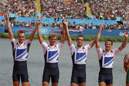 Britain's Peter Chambers, Rob Williams, Richard Chambers and Chris Bartley stand with their silver medals at the victory ceremony after placing second in the men's lightweight four finals rowing event during the London 2012 Olympic Games at Eton Dorney August 2, 2012. REUTERS/Darren Whiteside