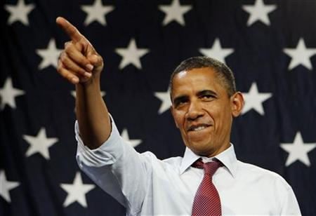 President Barack Obama points after he addresses a campaign event at the Harold & Ted Alfond Sports Center at Rollins College in Orlando, Florida, August 2, 2012. REUTERS/Larry Downing