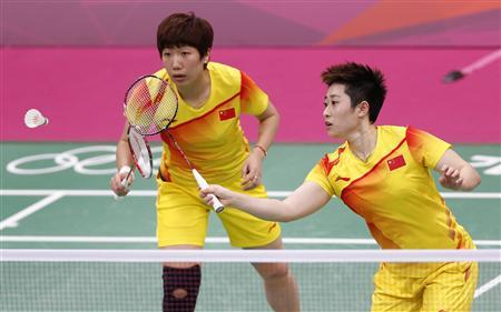 China's Wang Xiaoli and Yu Yang (R) play against South Korea's Jung Kyung-eun and Kim Ha-na during their women's doubles group play stage Group A badminton match during the London 2012 Olympic Games at the Wembley Arena in this July 31, 2012 file photo. Disqualified Chinese Olympic women's doubles player Yu Yang has quit badminton, she told her Chinese microblog. REUTERS/Bazuki Muhammad/Files