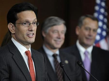 Eric Cantor (L) speaks during a news conference at the U.S. Capitol in Washington, December 22, 2011. REUTERS/Jonathan Ernst