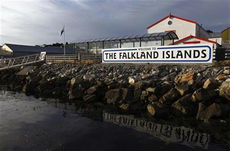 A ''Welcome to the Falkland Islands'' sign is seen at the end of a pier along the coast of Port Stanley March 17, 2012. REUTERS/Marcos Brindicci
