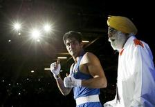 India's Vijender (L) leaves the ring after winning in his fight with Terrell Gausha of the U.S. in their Men's Middle (75kg) Round of 16 boxing match during the London 2012 Olympic Games August 2, 2012 REUTERS/Murad Sezer