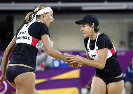 Austria's Stefanie (L) and Doris Schwaiger celebrate a point against Britain's Zara Dampney and Shauna Mullin during their women's lucky loser beach volleyball match at Horse Guards Parade during the London 2012 Olympic Games August 2, 2012. REUTERS/Dominic Ebenbichler