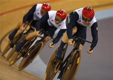 Britain's Philip Hindes, Chris Hoy and Jason Kenny compete in the track cycling men's team sprint gold finals at the Velodrome during the London 2012 Olympic Games August 2, 2012. REUTERS/Paul Hanna