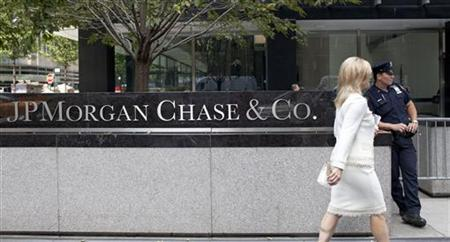 A woman walks past JPMorgan Chase & Co's international headquarters on Park Avenue in New York July 13, 2012. Jamie Dimon will do his best to put the ''London Whale'' trading flap behind him on Friday when JPMorgan Chase & Co reports earnings, telling Wall Street that the bank has capped losses from the bad trades and found the key risk management flaw behind the positions. REUTERS/Andrew Burton
