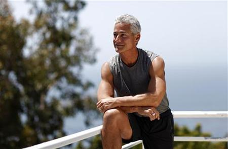 American Olympic diver Greg Louganis poses for a portrait at his home in Malibu, California May 18, 2012. REUTERS/Mario Anzuoni