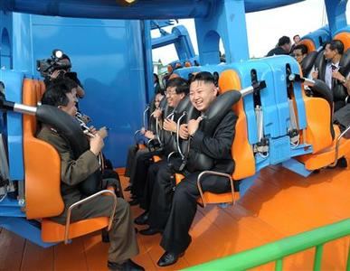 North Korean leader Kim Jong-Un prepares to take a ride with other high-level officials during the opening ceremony of the Rungna People's Pleasure Ground on Rungna Islet along the Taedong River in Pyongyang in this July 25, 2012 file photograph. REUTERS/KCNA