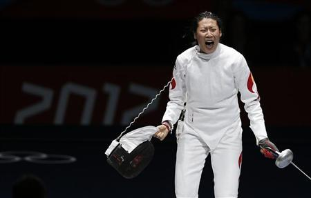 China's Sun Yujie celebrates defeating South Korea's Shin A Lam (not seen) during their women's epee individual bronze medal fencing match at the ExCel venue at the London 2012 Olympic Games July 30, 2012. REUTERS/Fabrizio Bensch