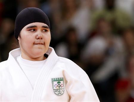 Saudi Arabia's Wojdan Shaherkani arrives ahead of her women's +78kg elimination round of 32 judo match against Puerto Rico's Melissa Mojica at the London 2012 Olympic Games August 3, 2012. REUTERS/Kim Kyung-Hoon