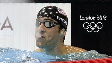 Michael Phelps of the U.S. reacts after placing first in his men's 100m butterfly semi-final during the London 2012 Olympic Games at the Aquatics Centre August 2, 2012. REUTERS/Tim Wimborne
