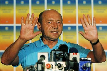 Romania's suspended President Traian Basescu gestures while addressing the media in Bucharest in this picture taken early July 30, 2012. REUTERS/Bogdan Cristel