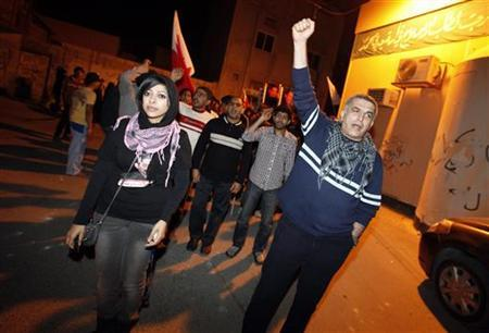 Zainab al-Khawaja (front L), daughter of human rights activist Abdulhadi al-Khawaja, and fellow human rights activist Nabeel Rajab (R) take part in a rally held in support of Abdulhadi al-Khawaja in the village of Bani-Jamra, west of Manama March 11, 2012. REUTERS/Hamad I Mohammed