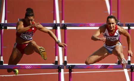 Jessica Ennis (R) of Britain and Hyleas Fountain of the U.S. compete in their women's heptathlon 100m hurdles heat during the London 2012 Olympic Games at the Olympic Stadium August 3, 2012. REUTERS/David Gray
