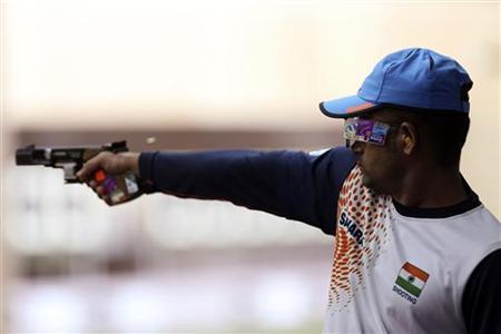 Vijay Kumar competes in the men's shooting 25m rapid fire pistol qualification round at the London 2012 Olympic Games at the Royal Artillery Barracks August 2, 2012. REUTERS/Sergio Moraes