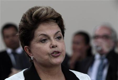 Brazil's President Dilma Rousseff talks to the press at the airport before leaving the G20 Summit, in Los Cabos June 19, 2012. REUTERS/Oswaldo Rivas