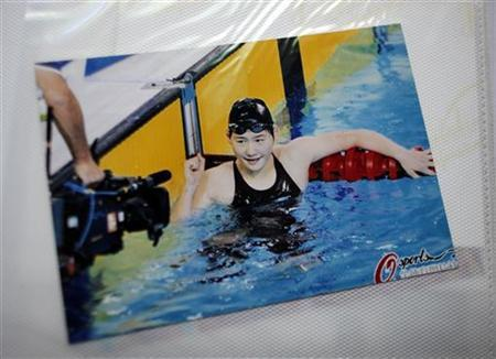 In this picture from a family album, Chinese Olympic swimmer Ye Shiwen celebrates after a competition, in Hangzhou August 2, 2012. REUTERS/Carlos Barria