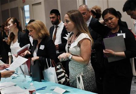 People speak with recruiters from jewelry and gem companies during the Gemological Institute Of America (GIA)'s Jewelry Career Fair in New York July 30, 2012. REUTERS/Shannon Stapleton