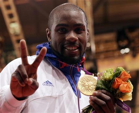 Gold medallist France's Teddy Riner poses at the victory ceremony for the men's +100kg judo event at the London 2012 Olympic Games August 3, 2012. REUTERS/Toru Hanai