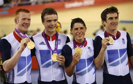 Britain's Ed Clancy (L), Geraint Thomas (R), Steven Burke and Peter Kennaugh (2nd R) pose with their medals during the victory ceremony after the track cycling men's team pursuit gold final at the Velodrome during the London 2012 Olympic Games August 3, 2012. Britain won the gold with a new world record of 3:51.659. REUTERS/Paul Hanna