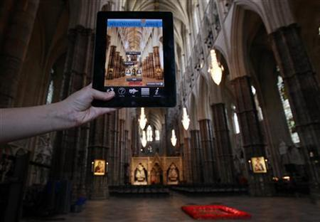 Abbey 3D - an app for Android, iPhone and iPad users is displayed at Westminster Abbey in central London April 20, 2011. REUTERS/Stefan Wermuth