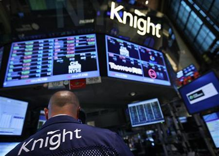 A trader works at the Knight Capital kiosk on the floor of the New York Stock Exchange August 1, 2012. REUTERS/Brendan McDermid