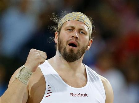 Poland's Tomasz Majewski reacts after his throw in the men's shot put final at the London 2012 Olympic Games at the Olympic Stadium August 3, 2012. REUTERS/Phil Noble