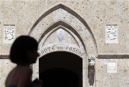 A woman strolls in front of Monte dei Paschi bank headquarters in Siena June 27, 2012. REUTERS/Stefano Rellandini